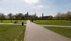 View across Burgess Park with proposed new development to the left St George's church