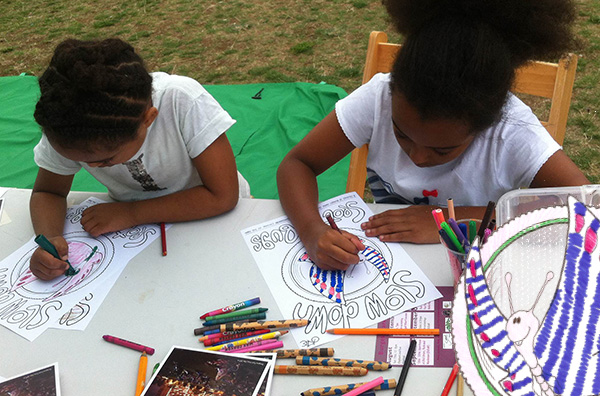 Photo of children in Burgess Park colouring cycling posters
