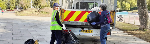 Litter pick volunteers load a rubbish truck