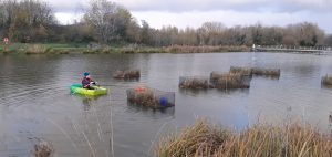 Islands being put in to position by TCV in boat.